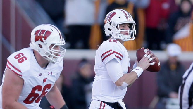 Wisconsin quarterback Alex Hornibrook looks to pass with protection from Beau Benzschawel. Hornibrook was completed 15 of 19 passes for 151 yards with three touchdowns and no interceptions.