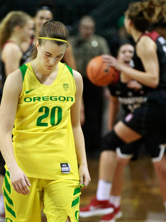 Oregon's Sabrina Ionescu, left, leaves the court as Stanford players celebrate their win in an NCAA college basketball game Sunday Feb 4, 2018. (Chris Pietsch/The Register-Guard via AP)