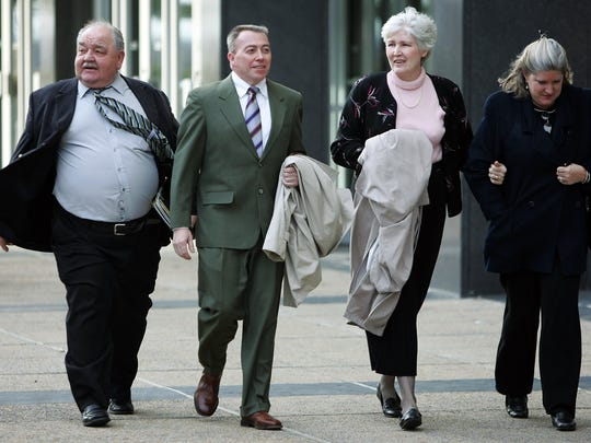 February 28, 2005 - O.C. Smith, second from left, leaves the Federal Courthouse with defense team member J.D. Douglas, left, wife Marge, third from left, and an unidentified woman at far right.