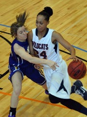 Louisiana College's Anna Phillips (24, right) drives past Hardin-Simmon's Danie Mabry (14, left) Saturday, Feb. 7, 2015.