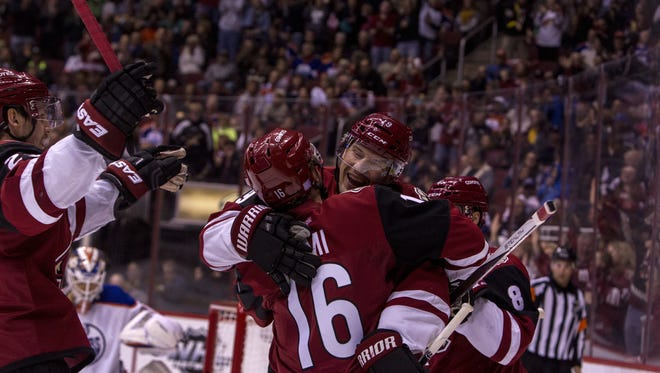 Arizona's Max Domi celebrates with Shane Doan after Doan scored a goal against Edmonton in the second period on Thursday, Nov. 12, 2015 at Gila River Arena in Glendale, AZ.