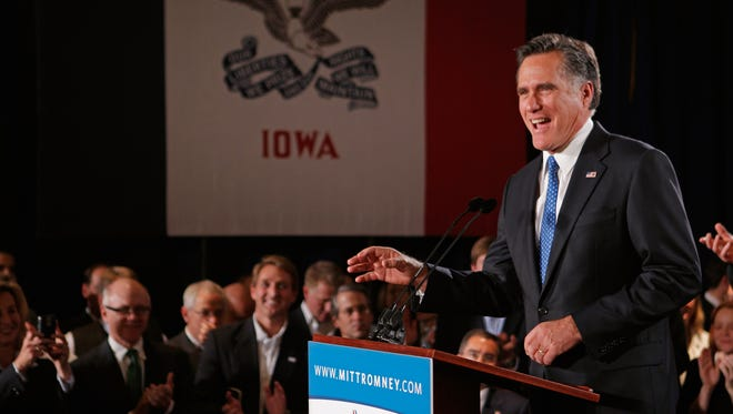 Mitt Romney speaks at the Hotel Fort Des Moines on the night of the 2012 Iowa GOP caucuses in Des Moines.