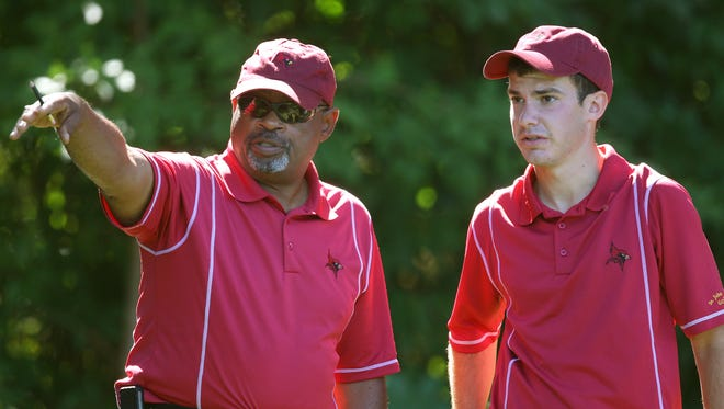 St. John Fisher coach Bob Simms, left, gives instructions to junior Karl Deuble. The Cardinals are one of 41 teams in the Division III men's golf championships Tuesday through Friday at Midvale Country Club and Mendon Golf Club.