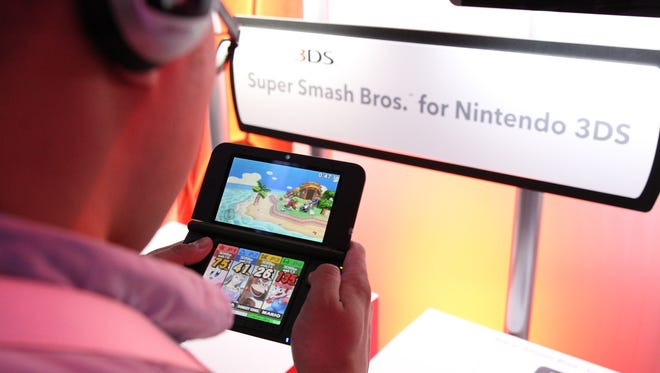 Attendees playing Super Bash Bros on the Nintendo 3DS during the Electronic Entertainment Expo in Los Angeles in 2014.