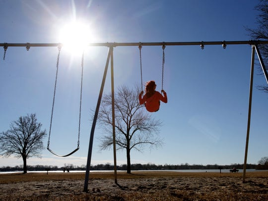 Nikk Baxter, 27 of Fenton enjoys the record-setting weekend weather at Pontiac Lake Recreation Area in Waterford, Michigan, on Feb. 28, 2017. A repeat of last year's La Niña weather conditions could mean mild conditions to come again -- but only if the jet stream and the cold, Canadian Arctic air it carries in winter are mostly held above the Great Lakes.