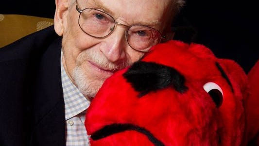Author and cartoonist Norman Bridwell, creator of Clifford the Big Red Dog, poses for a portrait at Scholastic headquarters in New York, May 4, 2011.