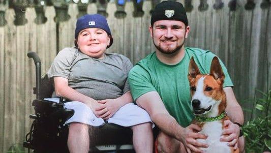 Kolten Fullenkamp, left, sits with his older brother, Braxton, and his beloved dog, Rudi Bo. Kolten Fullenkamp died Sunday after a car crash.
