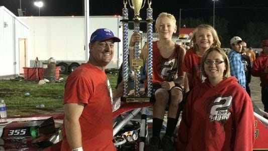 Kevin Sharp, 41, his son Sterling Wayne Sharp, 12, daughter Adrianna Marie Sharp, 7, and his wife Amy Marie Sharp, 38, all of Creston, Iowa, pose for a photo on victory lane following a September 2017 stock-car race at Adams County Speedway in Corning, Iowa.