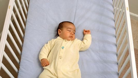 This photo illustrates a safe sleep environment for a baby, in which the risks of Sudden Infant Death Syndrome (SIDS) and other sleep-related causes of infant death are low.