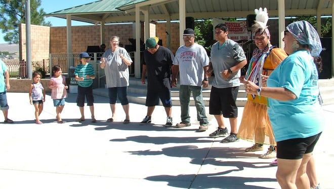Shannon Hooper, former Miss Indian Nations, second from right, led the visitors in a Native American round dance at the Fernley Multi-Cultural Festival held over the weekend at the Out-of-Town Park.