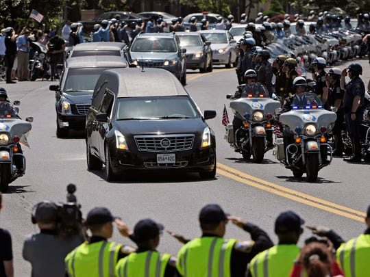 The hearse bearing the body of fallen Baltimore County Police Officer Amy Caprio arrives at Dulaney Valley Memorial Gardens, in Lutherville-Timonium, Md., Friday, May 25, 208. Caprio was run over by a Jeep while investigating a burglary Monday at a house in Perry Hall. (Kim Hairston/The Baltimore Sun via AP)