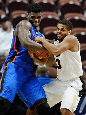 Florida's John Egbunu, left, and Purdue's P.J. Thompson wrestle for possession of the ball during the second half of an NCAA college basketball game in the Hall of Fame Tip-Off tournament, Sunday, Nov. 22, 2015, in Uncasville, Conn. Purdue won 85-70. (AP Photo/Jessica Hill)
