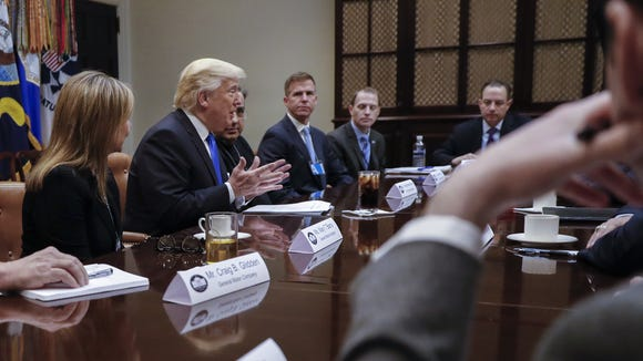 Vice Presidential Chief of Staff Josh Pitcock, second from right, looks on as President Donald Trump meets with automobile company executives in the Roosevelt Room of the White House, Jan. 24, 2017.
