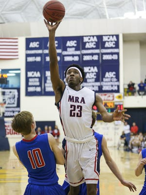 MRA's Davin Gilmore (23) hits a shot in the lane in the first half against Simpson Academy in the MAIS Overall boys championship on Saturday at Mississippi College in Clinton. MRA won 57-44.