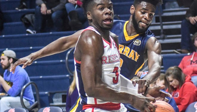 Ole Miss guard Terence Davis is defended by Murray State guard Jonathan Stark in Thursday's game in Oxford.