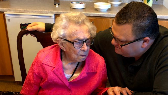 Mary Lincoln of Chester visits with her grandson Duane Lincoln as her family celebrates her recent 106th birthday.