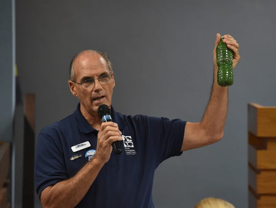 Mark Perry, of the Florida Oceanographic Society, holds