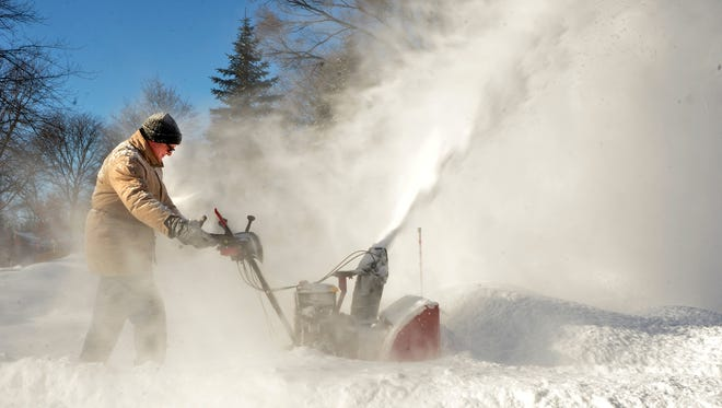 Schools closed early and snow emergencies have been declared in some communities as Metro Detroit braces for a significant winter storm.