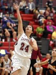 Sophomore wing Brooke Huerta (24) fits in neatly at