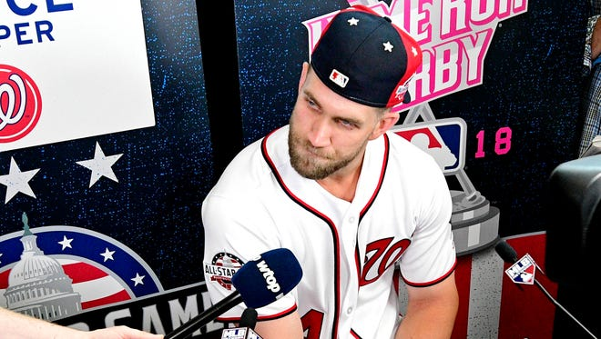 Bryce Harper talks with reporters ahead of Monday's Home Run Derby.