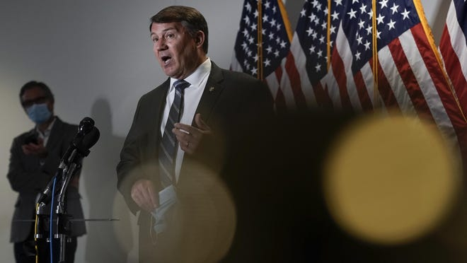 Sen. Mike Rounds, R-S.D., takes questions from reporters about proposed policing reforms after President Donald Trump signed an executive order on police reform on Capitol Hill in Washington, Tuesday, June 16, 2020.