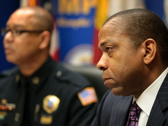 Memphis Director of Police Michael Rallings, left, and the city's chief legal officer, Bruce McMullen