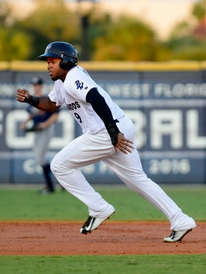 Pensacola Blue Wahoos runner Phillip Ervin steals thrid base Tuesday while playing the Mississippi Braves at Bayfront Stadium.