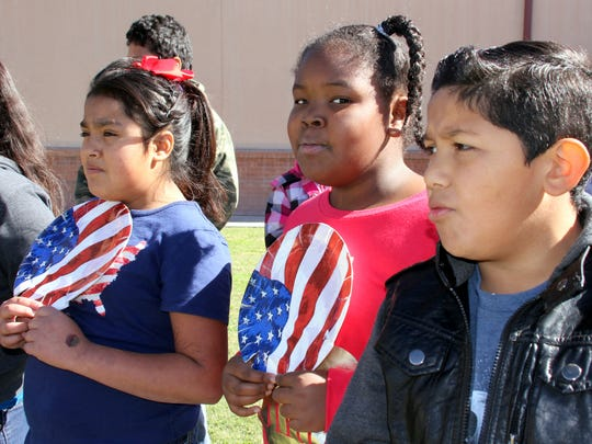 From left, Jaylean Contreras, Malika Pettigrew and Paul Navarro sang patriotic songs with the Bell Elementary School fourth graders.