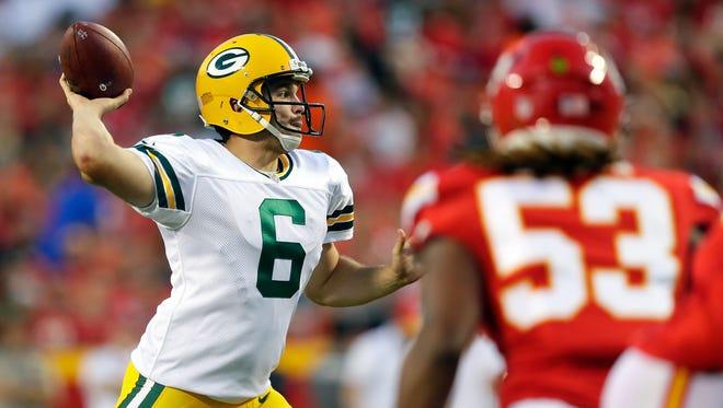 Packers quarterback Joe Callahan passes as Ramik Wilson defends.
