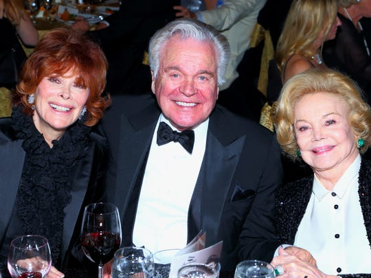 Jill St. John, Robert Wagner and Barbara Sinatra attend a past Frank Sinatra Celebrity Invitational golf gala.