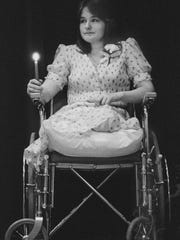 Malinda Lamb at the age of 16 in 1981 after losing her legs in an accident involving a train in central Louisville. Her recovery and determination to regain her life and mobility is the subject of these photographs. From the day of her accident, February 28, 1981, through her graduation from high school in 1982, Malinda's story is one of strength and courage. Pictured here, Malinda at her National Honor Society induction ceremony.