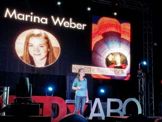 "Marina Weber, 12, addresses an audience at the TEDxYouth conference in Albuquerque. The Santa Fe youth is a climate activist and author. Her book, ""The Global Warming Express,"" has prompted change in her community and beyond."