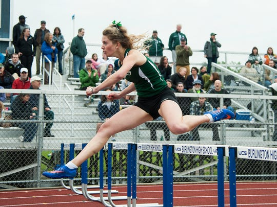 St. Johnsbury's Katherine Cowan leaps over the huddle in first place during the girls 300m hurdles race during the division I high school track and field state championships at Burlington High School on Saturday June 3, 2017 in Burlington. (BRIAN JENKINS/for the FREE PRESS)