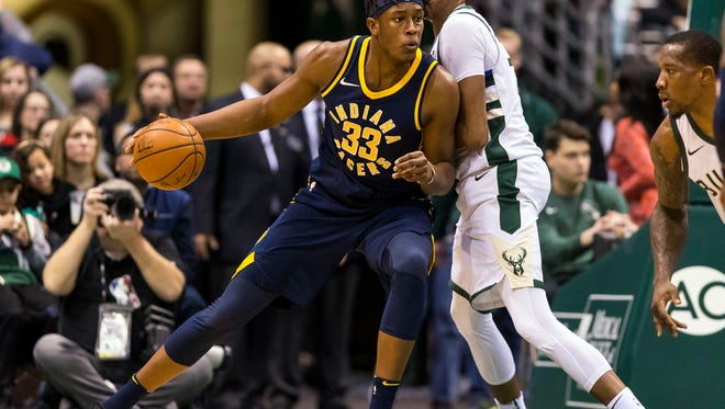 Jan 3, 2018; Milwaukee, WI, USA; Indiana Pacers center Myles Turner (33) backs down Milwaukee Bucks forward John Henson (31) during the first quarter at BMO Harris Bradley Center. Mandatory Credit: Jeff Hanisch-USA TODAY Sports