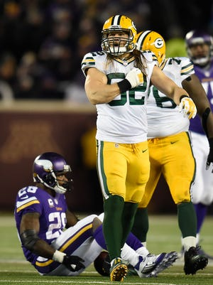 Green Bay Packers linebacker Clay Matthews (52) reacts after stopping Minnesota Vikings running back Adrian Peterson (28) in the third quarter during Sunday's game at TCF Bank Stadium in Minneapolis, Minn.