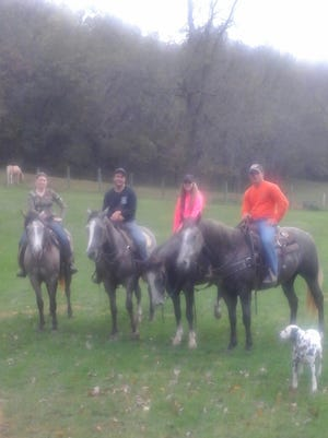 Darin Hampton, Mya Riniker, Traci Wilkinson  and Tim Roelefson gather at the 31st annual Pie Ride, reuniting four colts sired by CR Smokes Midnight.