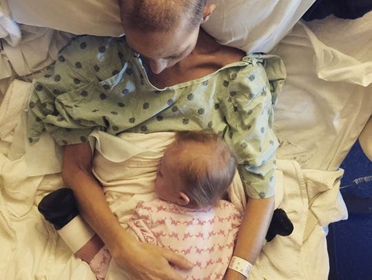 Joey Feek and her daughter, Indiana, cuddle in bed