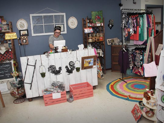 """Tyler Walker, owner of Gracy Lu's, here surrounded by her collection of ever-changing """"inspired eclecticism."""""""