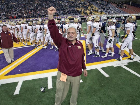 Ankeny coach Jerry Pezzetti salutes the fans after the Hawks defeated Cedar Rapids Xavier in the Class 4A championship game in the 2012 football playoffs at Cedar Falls. Pezzetti, who is now the co-head coach at Ankeny Centennial, returned to the UNI-Dome on Friday to receive the Walt Fiegel Coaching with Character Award during halftime of the Class 4A title game between Dowling Catholic and Iowa City West.