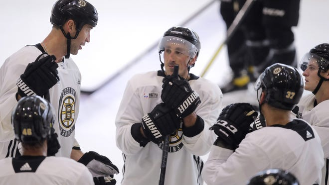 Boston's Zdeno Chara, top left, talks with teammates during training camp earlier this week. From left are David Krejci, Chara, Brad Marchand, Patrice Bergeron and Torey Krug.
