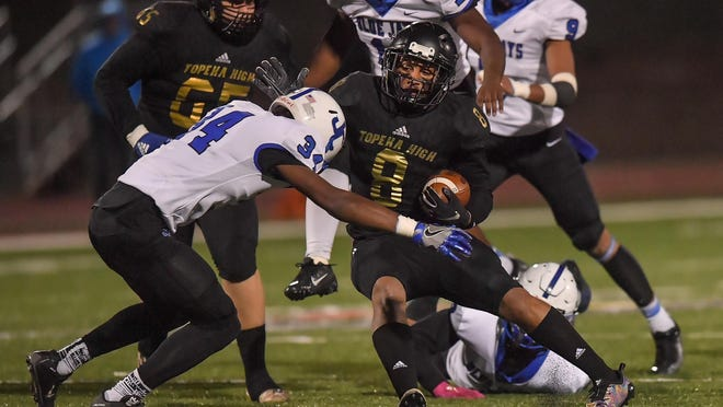 Topeka High's Ky Thomas spins around Junction City's Chazaya Ruffin. Thomas, who ran for 7,703 career yards, was named Kansas' top football player for the 2019 season on Thursday night during the Best of Kansas Preps awards show.