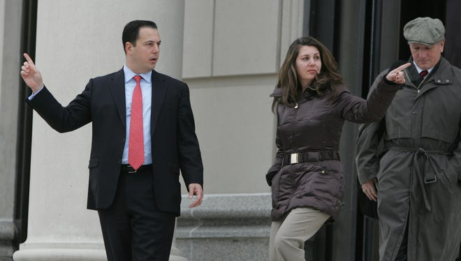 Disgraced lawyer Anthony Mangone, at left, leaves the U.S. District Courthouse in White Plains in 2010 after being indicted on federal corruption charges.