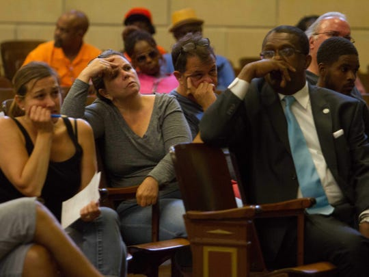 Members of the public sit through a town hall meeting on violence in Wilmington. The residents later grew frustrated with the process and stormed out, complaining that too many in the audience were preaching and not giving questions and receiving answers.