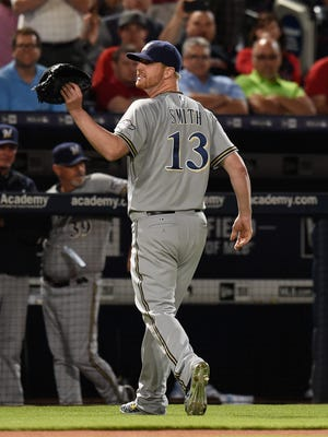 Brewers relief pitcher Will Smith reacts after he was ejected from the game.