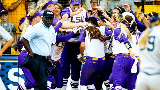 LSU's Bailey Landry is mobbed at home plate after hitting a two-run homer.