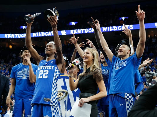 Kentucky players celebrate after beating Tennessee 77-72 in an NCAA college basketball championship game at the Southeastern Conference tournament Sunday, March 11, 2018, in St. Louis. (AP Photo/Jeff Roberson)