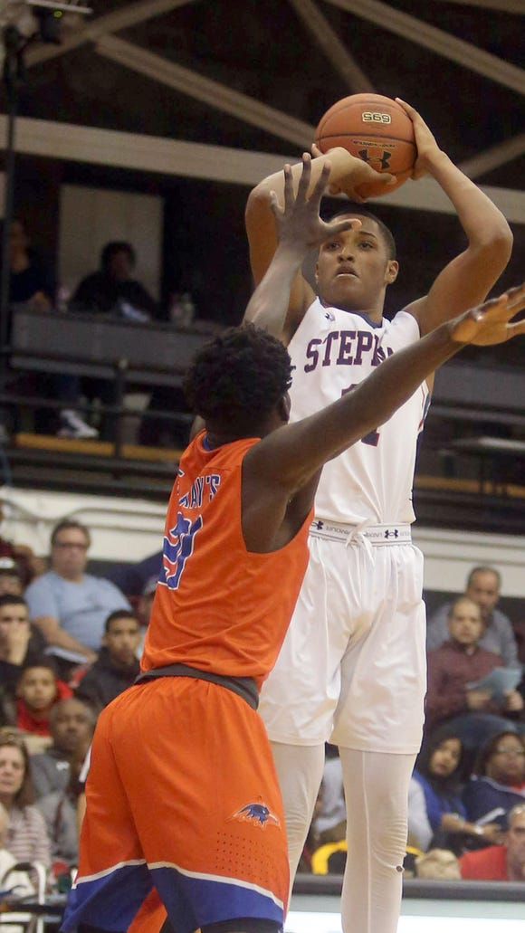 Stepinac's St. Joel Soriano shoots during the CHSAA