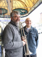 "Gary Wallmark, with the vintage trombone, stands with Keith Weathers, who conducted Salem Concert Band's annual ""In the Steps of Sousa"" concert in March. Six Salem-Keizer students won awards in the band's essay contest about John Philip Sousa."