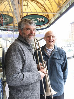 """Gary Wallmark, with the vintage trombone, stands with Keith Weathers, who conducted Salem Concert Band's annual """"In the Steps of Sousa"""" concert in March. Six Salem-Keizer students won awards in the band's essay contest about John Philip Sousa."""