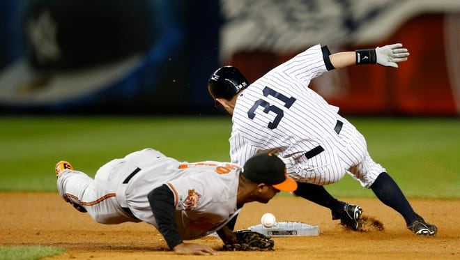 The ball skips away from Orioles second baseman Jonathan Schoop as the New York Yankees' Ichiro Suzuki steals second in the seventh inning Monday at Yankee Stadium in New York.